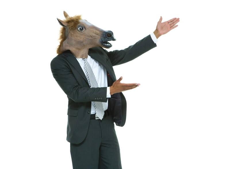 Businessmann mit Pferdemaske