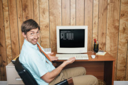 Mann im Büro in den 80er Jahren
